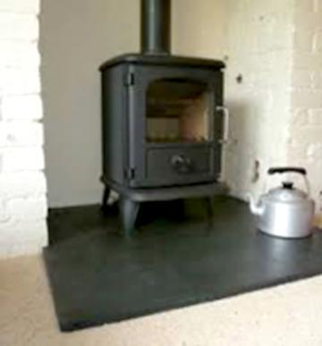 Black-hearth-with-stove-nggid0216-ngg0dyn-250x188x100-00f0w010c010r110f110r010t010